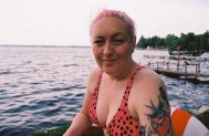 woman sitting by canadian lake