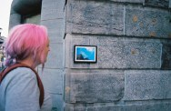 Lady looking at street art