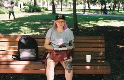 women sitting on bench in park