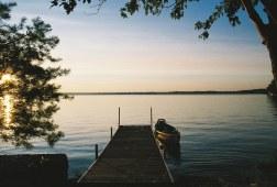 Pontoon canoe lake at sunset
