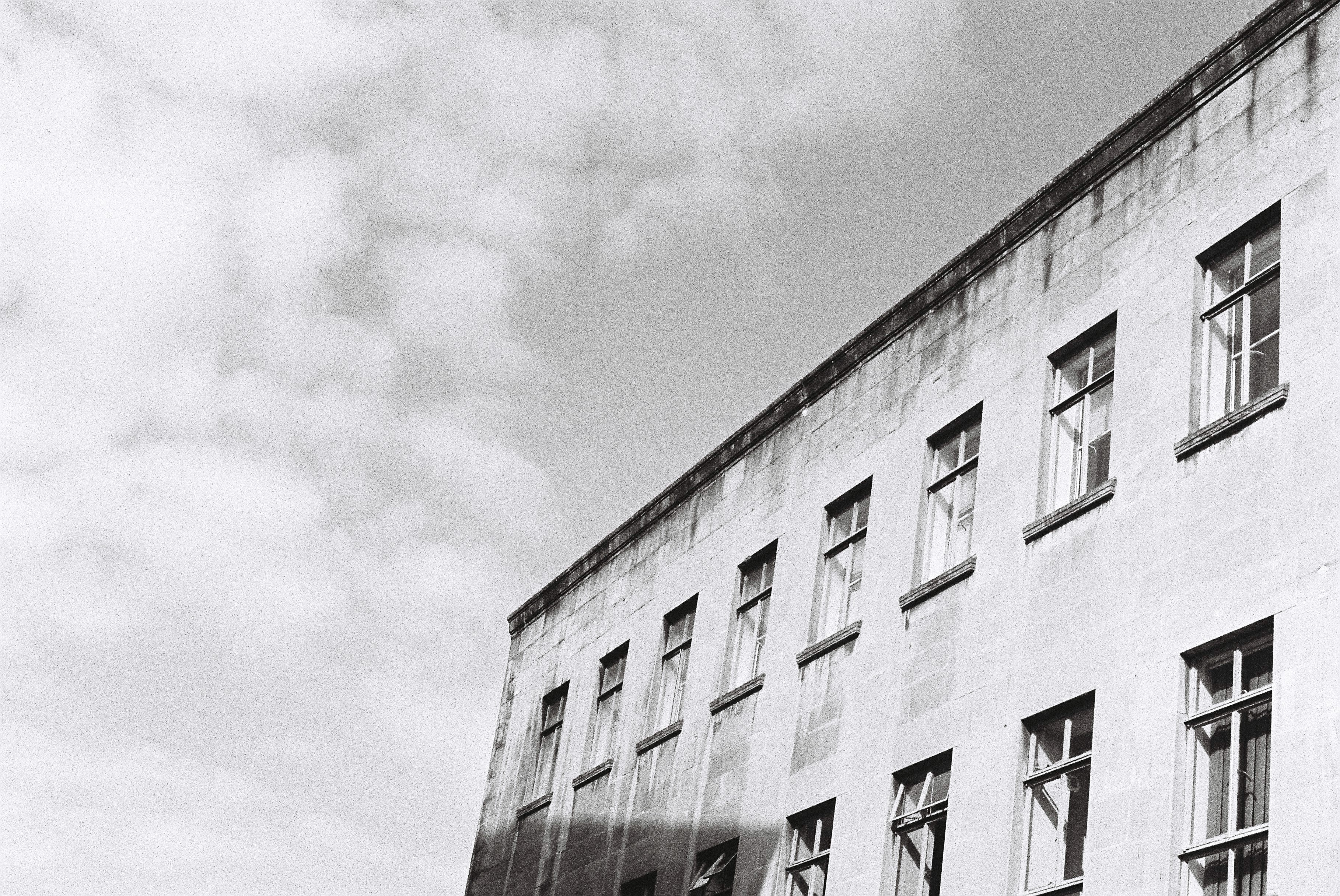 black and white photography building clouds