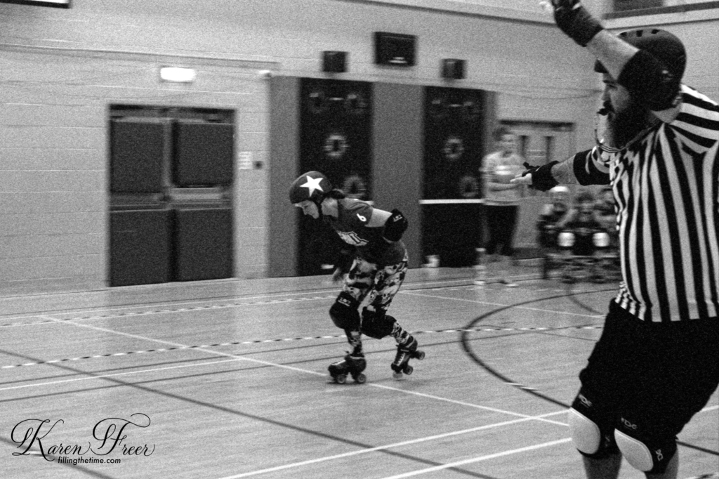 Roller Derby Jammer and Referee B&W Kodak TMAX 6400iso Bout Against Cancer